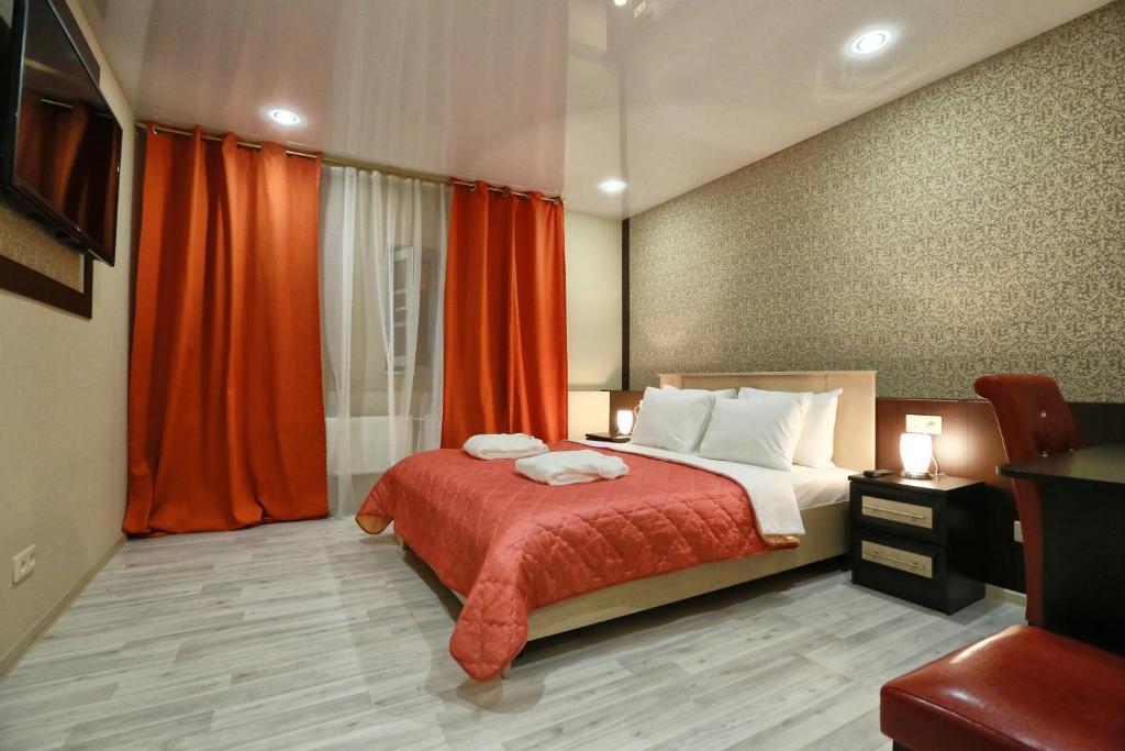 A bed or beds in a room at Elysium Hotel at Pushkinskaya