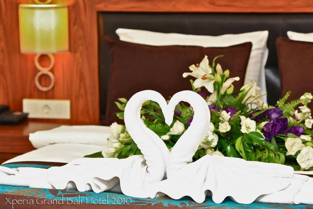 Кровать или кровати в номере Xperia Grand Bali Hotel - All Inclusive