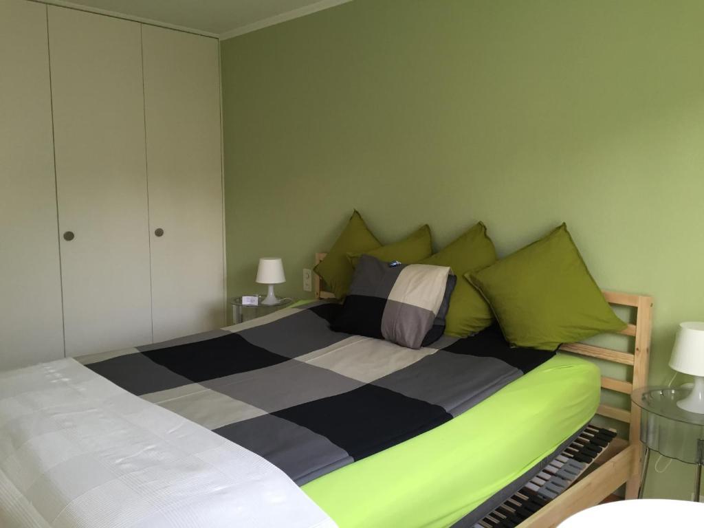 Ein Bett oder Betten in einem Zimmer der Unterkunft Dependance Huus zur Vielfalt