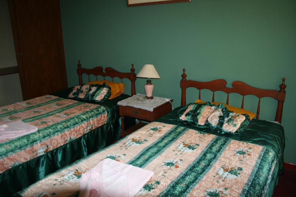 A bed or beds in a room at Hotel Las Lineas