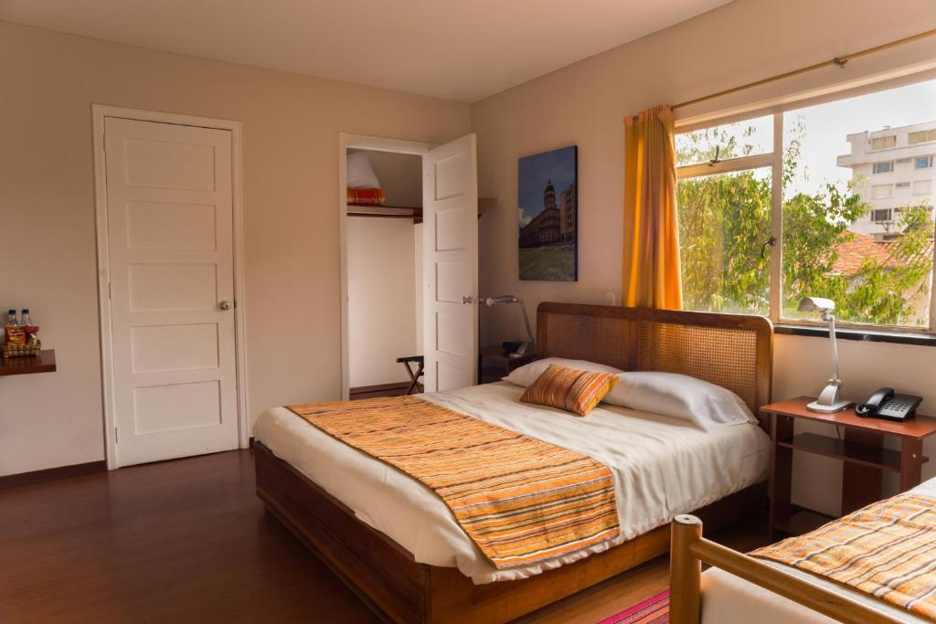 A bed or beds in a room at Hotel Casona del Patio