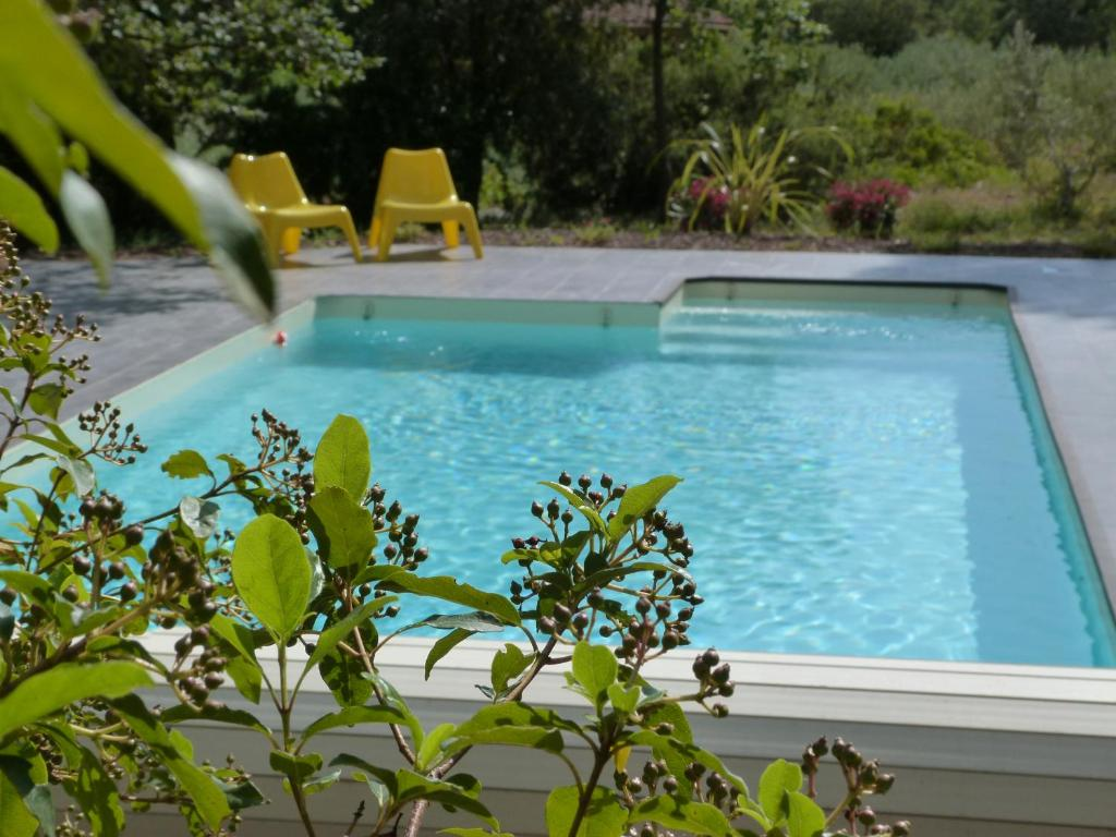 The swimming pool at or near Le Mas De La Flaquiere