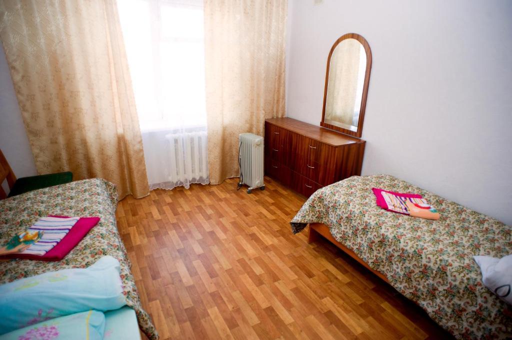 Кровать или кровати в номере Hostel Trukhinova 3