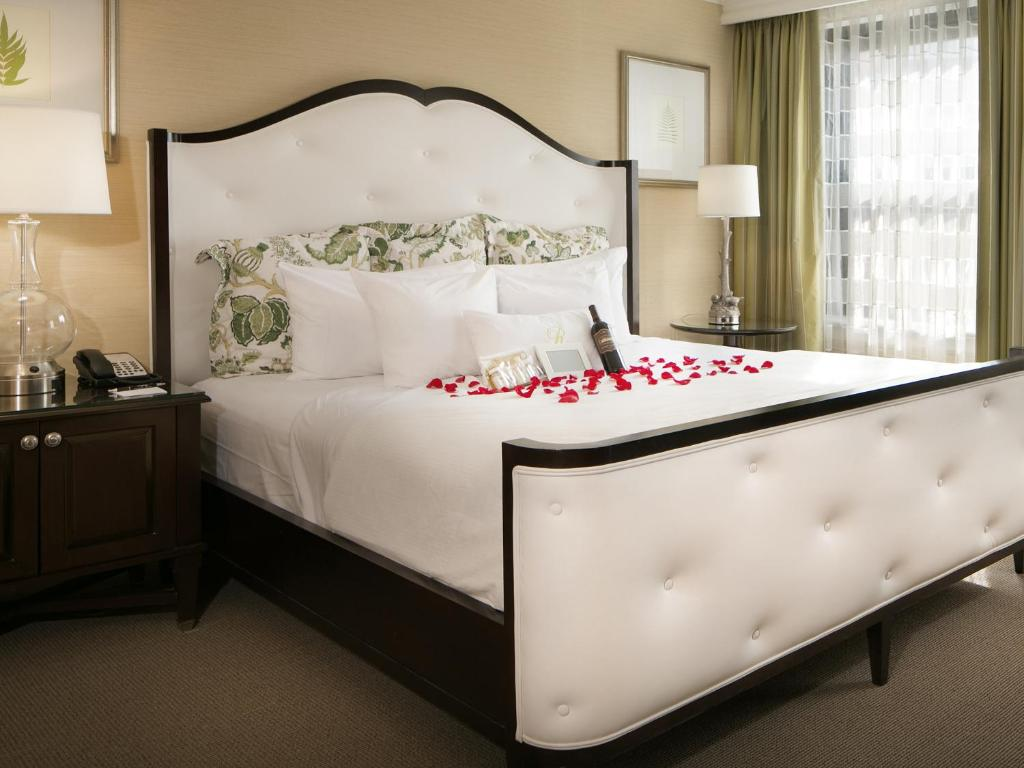 A bed or beds in a room at The Raphael Hotel, Autograph Collection
