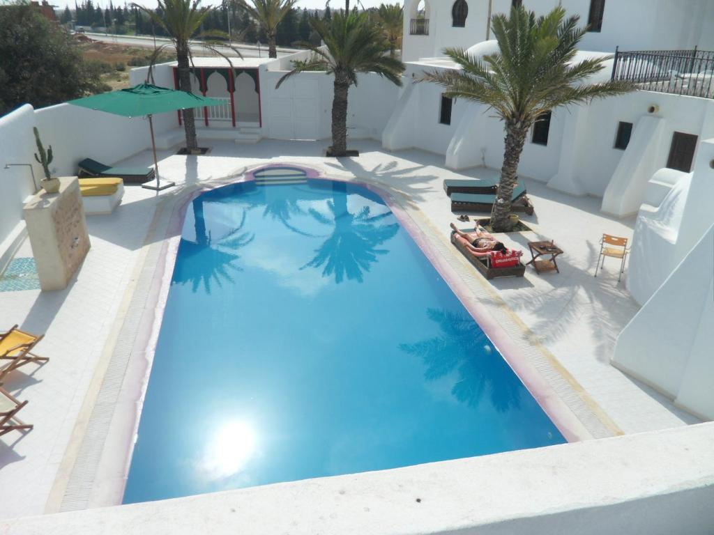 A view of the pool at Maison Leila or nearby