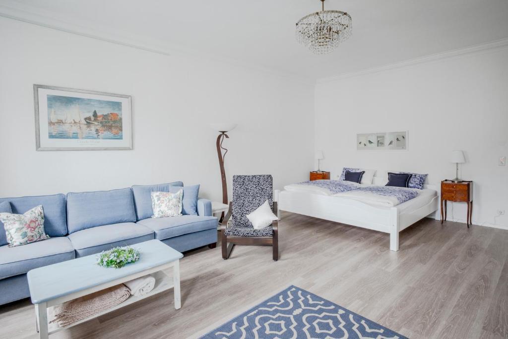 Ein Bett oder Betten in einem Zimmer der Unterkunft Ferienwohnung Stadtplatz 25