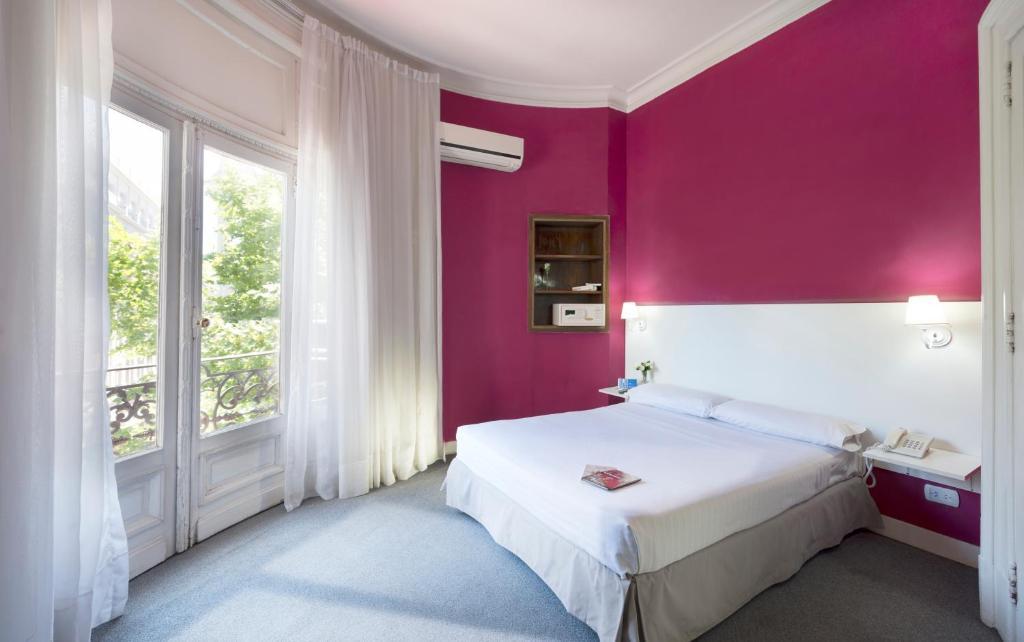 Lova arba lovos apgyvendinimo įstaigoje Hotel Mundial