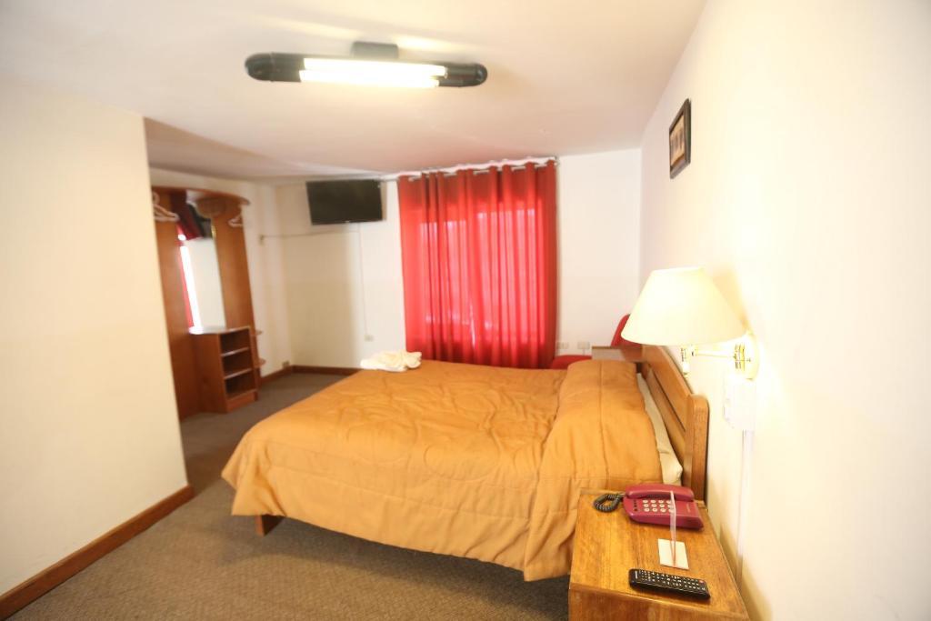 Cama o camas de una habitación en Antares Mystic Hotel