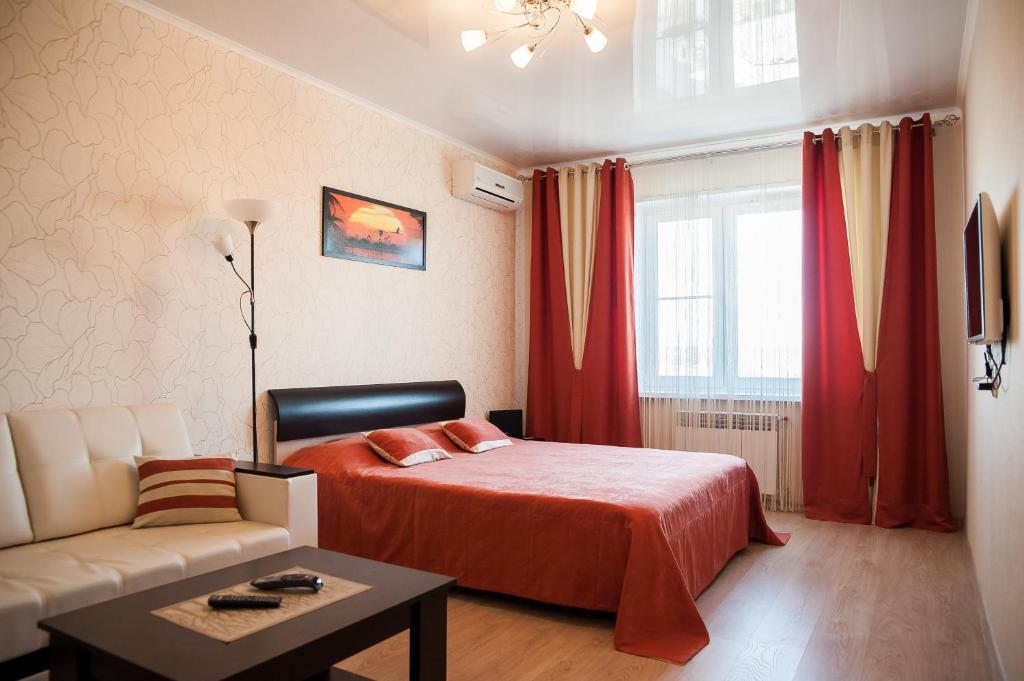 Кровать или кровати в номере Apartment Ternopolskaya 18