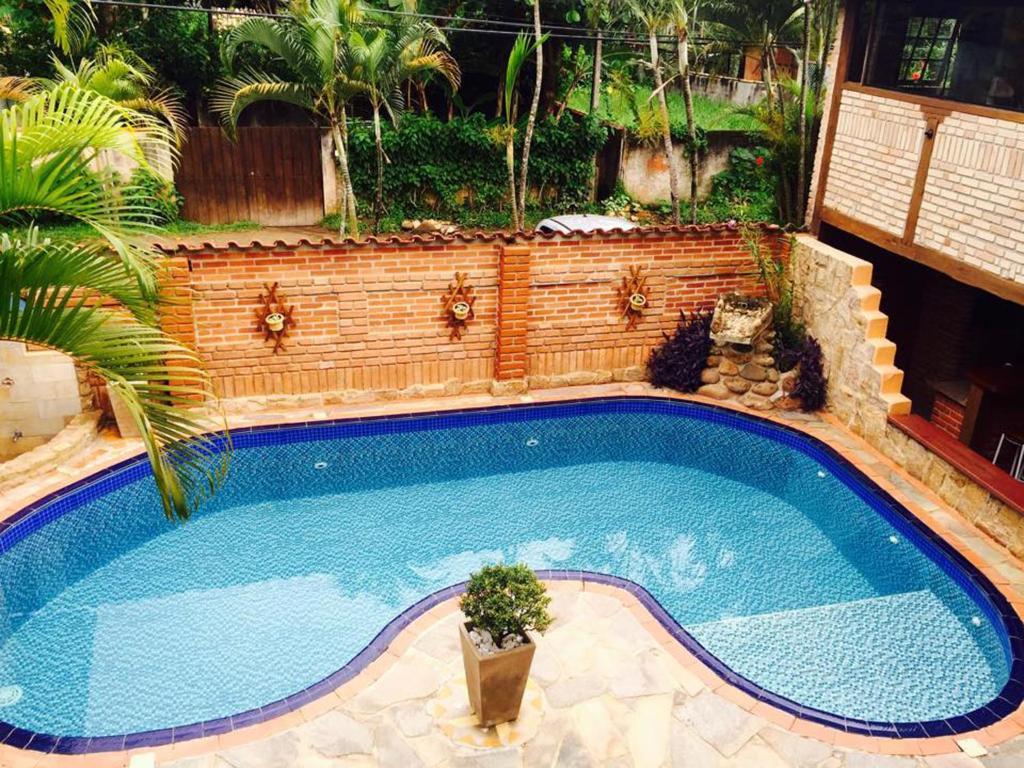 The swimming pool at or near Pousada Kyrios