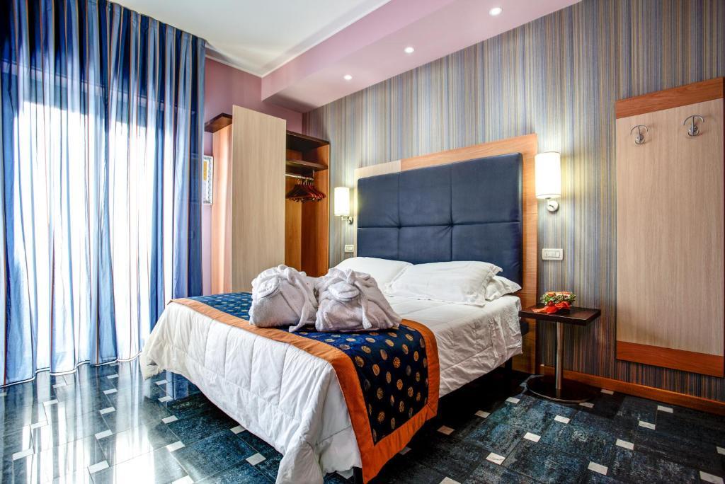 Voodi või voodid majutusasutuse Hotel Genty toas