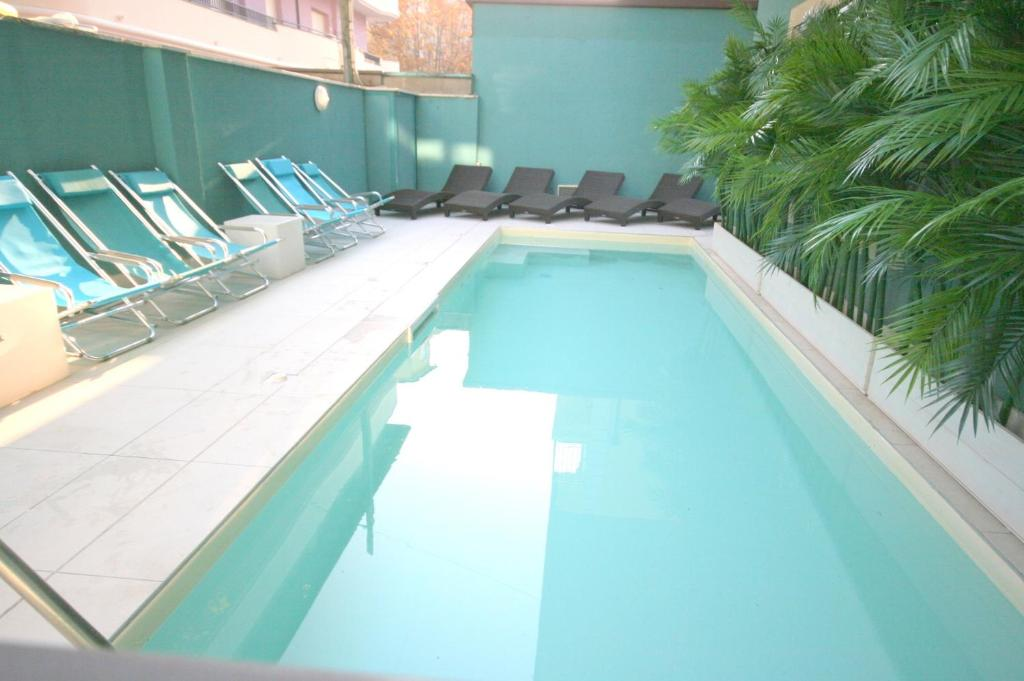The swimming pool at or near Residence Beach Paradise