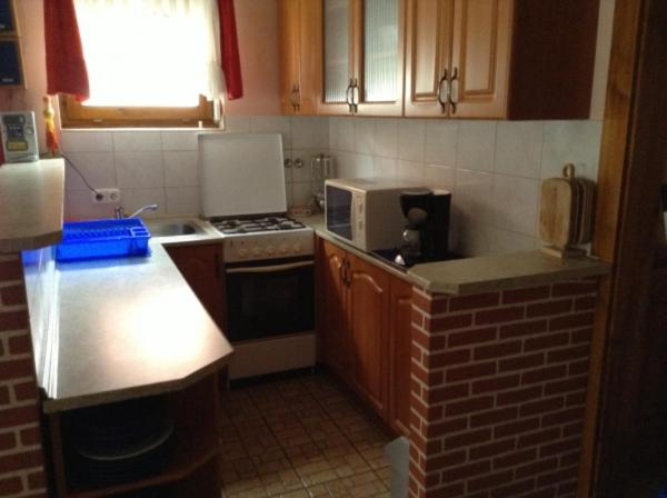 Kuchyň nebo kuchyňský kout v ubytování Szemán Apartman