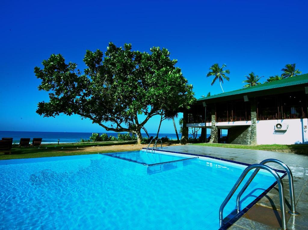 The swimming pool at or near Koggala Beach Hotel