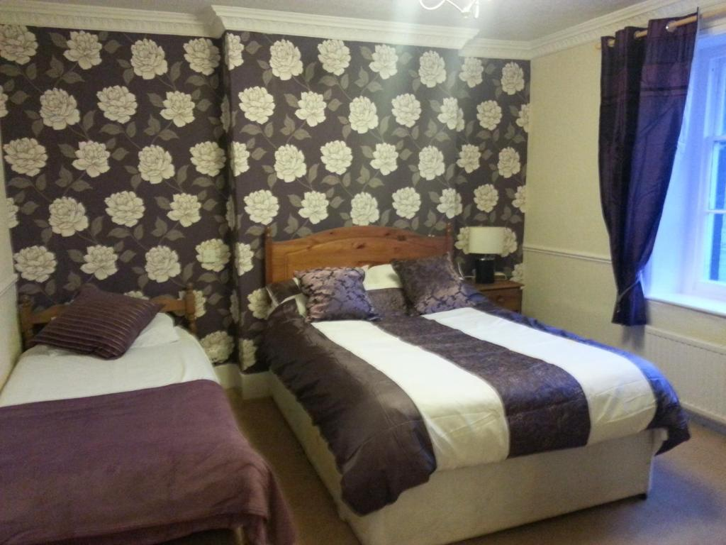 A bed or beds in a room at The Penruddocke Arms