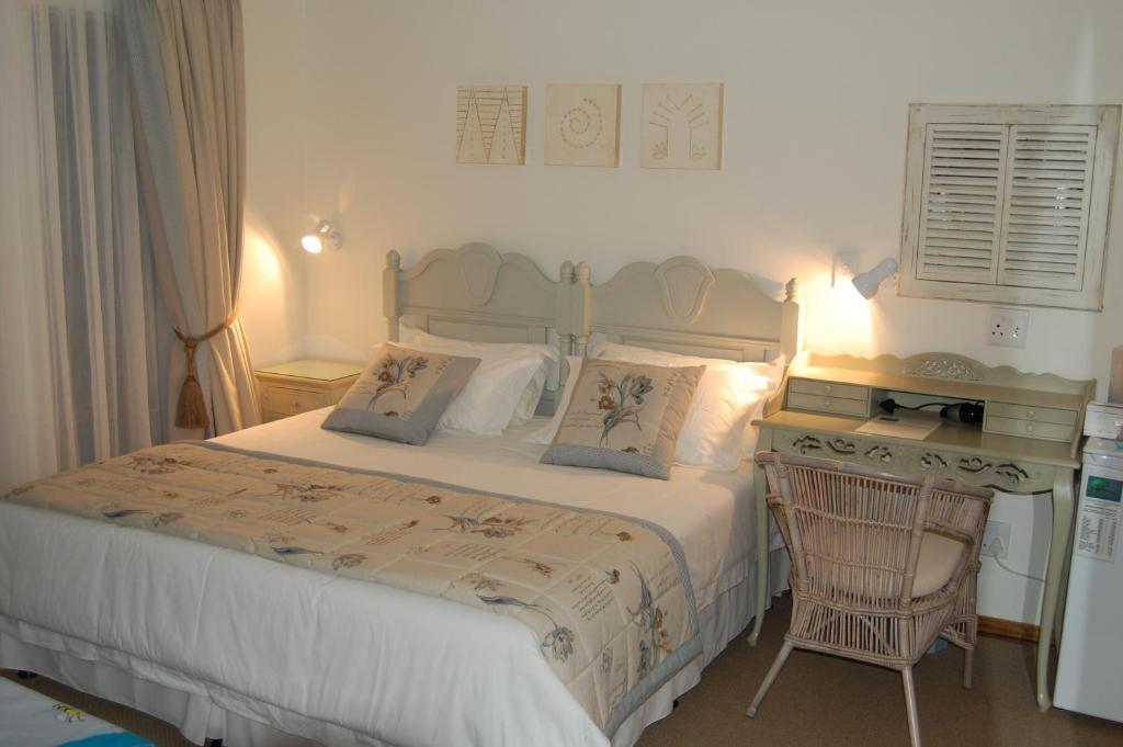 Gulta vai gultas numurā naktsmītnē Sandstone Chameleon Guest House