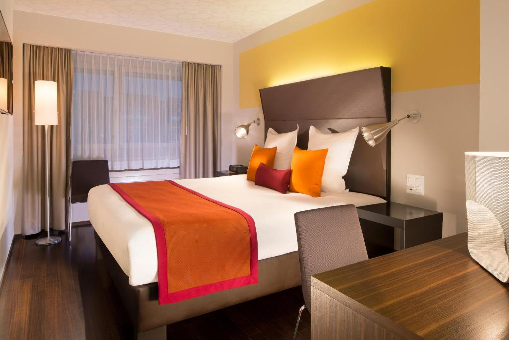 A bed or beds in a room at Hotel D - Design Hotel