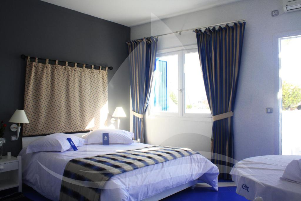 A bed or beds in a room at Marina Cap Monastir- Appart'hôtel