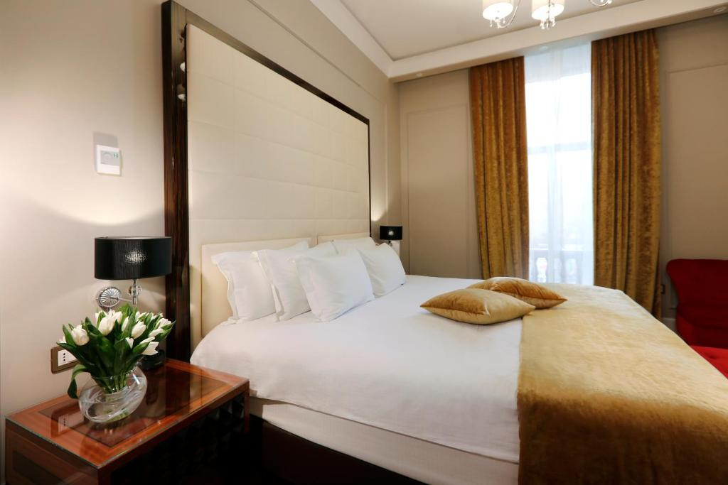 A bed or beds in a room at Grand Hotel Yerevan - Small Luxury Hotels of the World