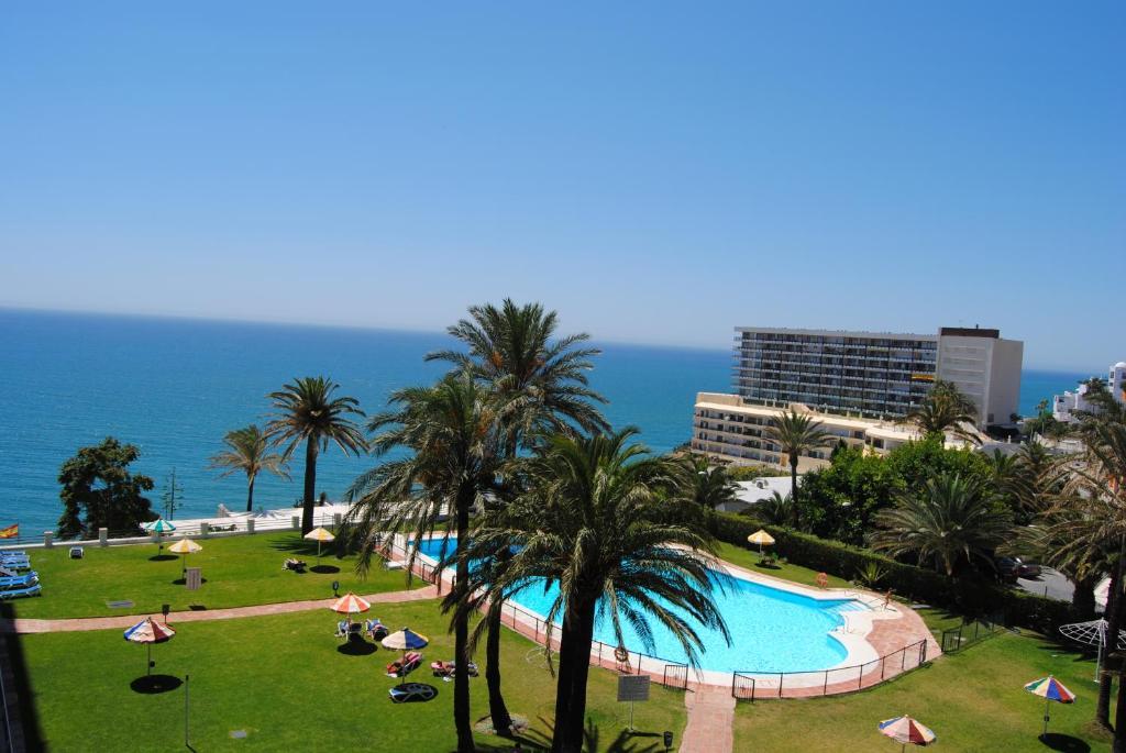A view of the pool at Apartamentos Torre de la Roca or nearby