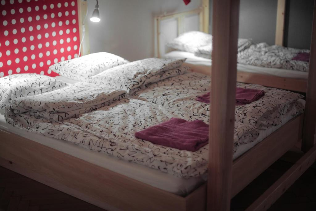 A bed or beds in a room at Hipster Hostel