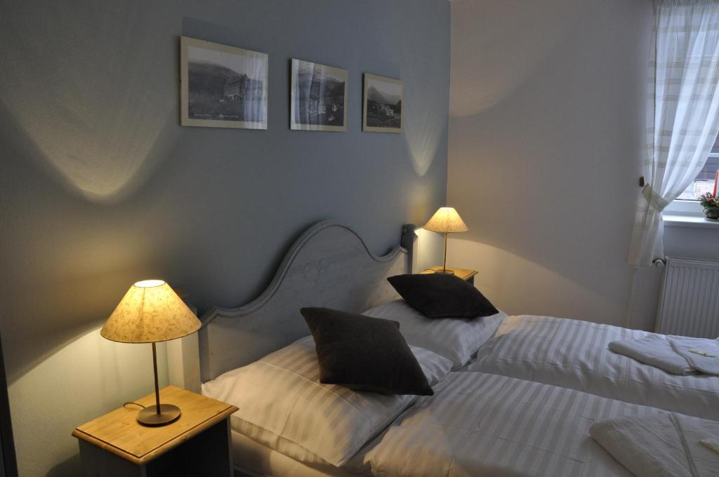 A bed or beds in a room at Pension Grand Apartments