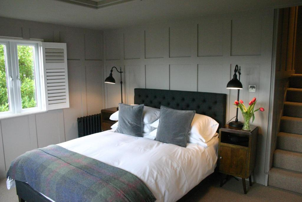 A bed or beds in a room at Number Fifty Town House