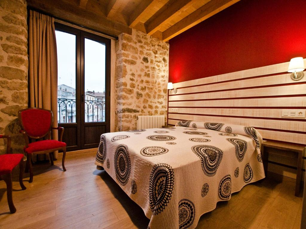 A bed or beds in a room at La Casa de Beli