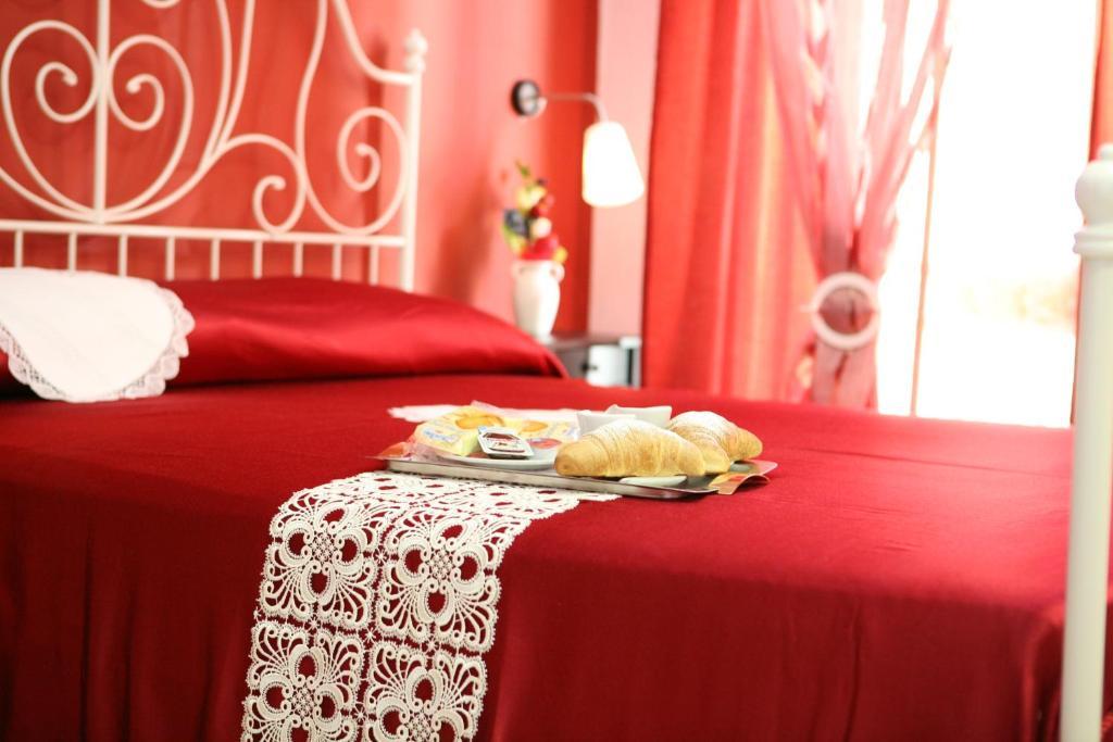 Cama o camas de una habitación en B&B Dolcevita