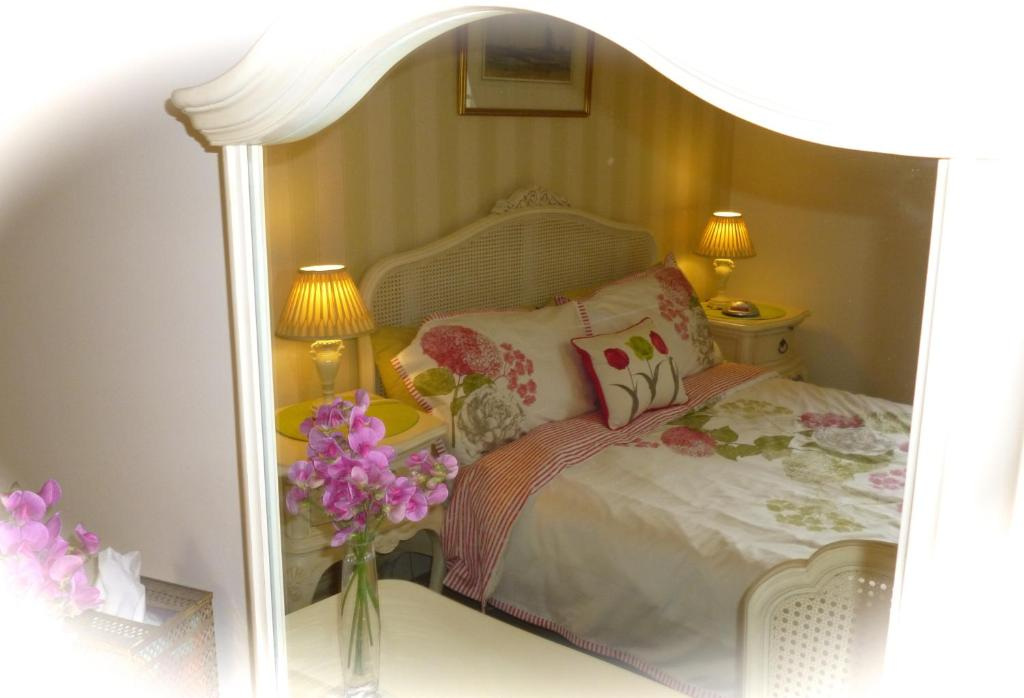 A bed or beds in a room at Copperfields Guest House