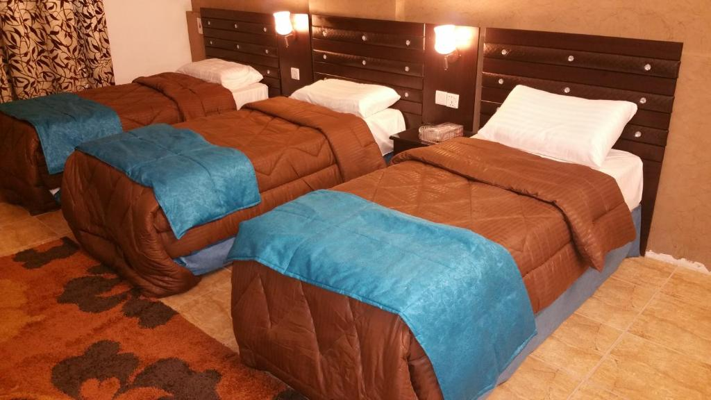 A bed or beds in a room at Burj Al Balad Hotel Apartments