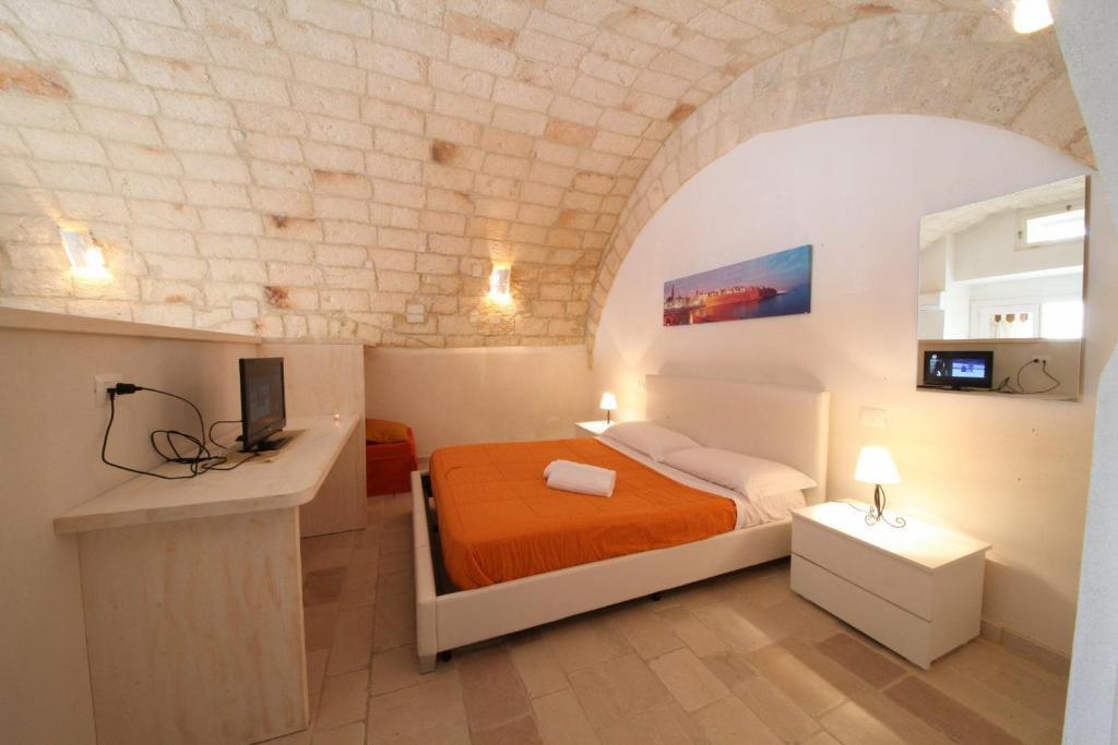 Łóżko lub łóżka w pokoju w obiekcie B&B Il Porto Di Ciccia'