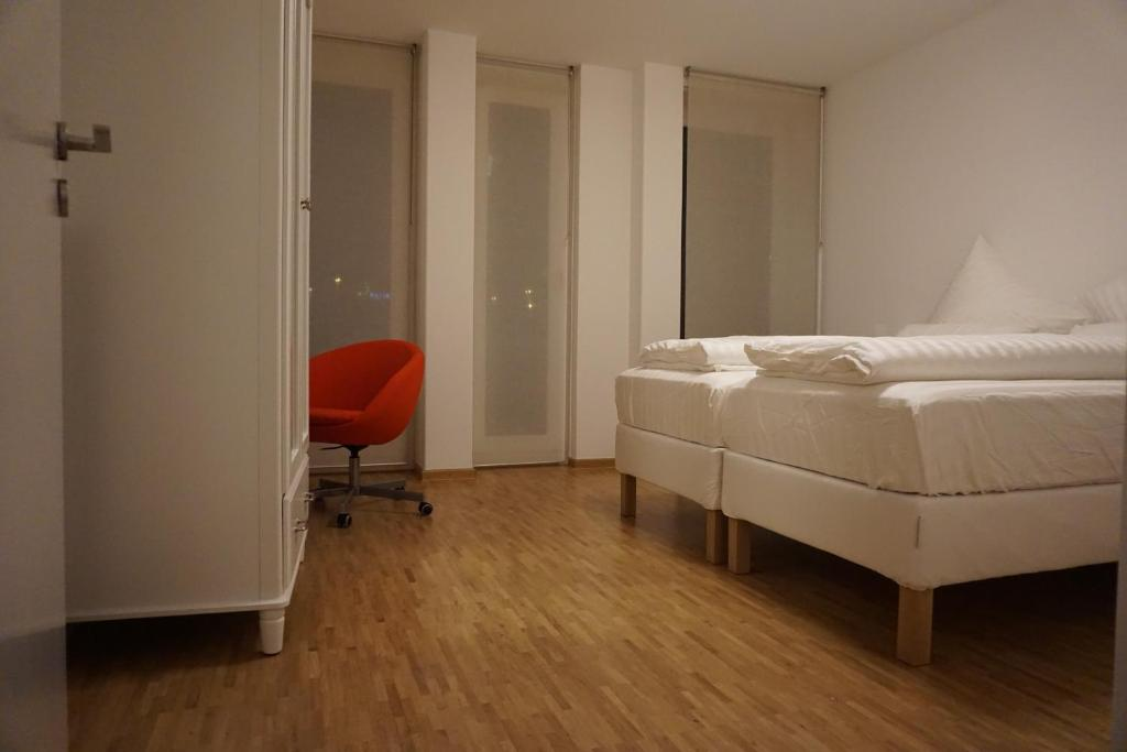 Ein Bett oder Betten in einem Zimmer der Unterkunft Deluxe Apartment Cologne