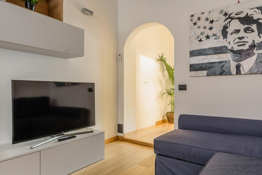 A television and/or entertainment center at Corso Como Luxury Apartment