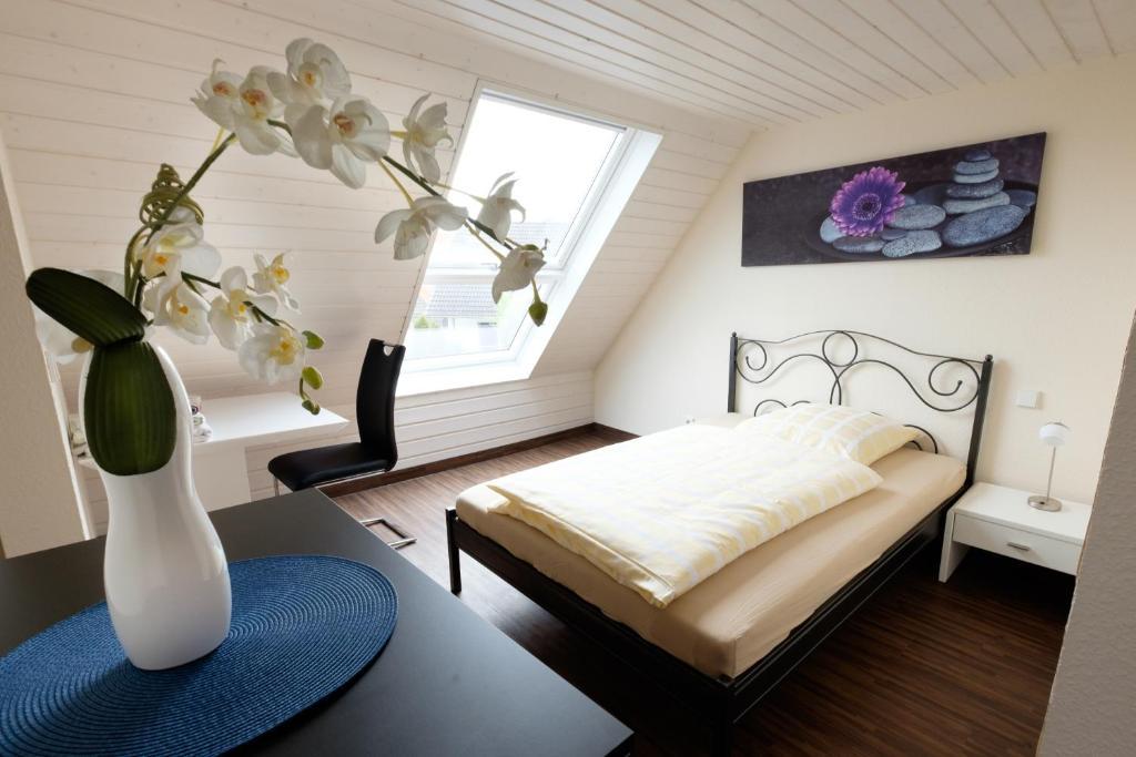 Ein Bett oder Betten in einem Zimmer der Unterkunft Haus am Asang