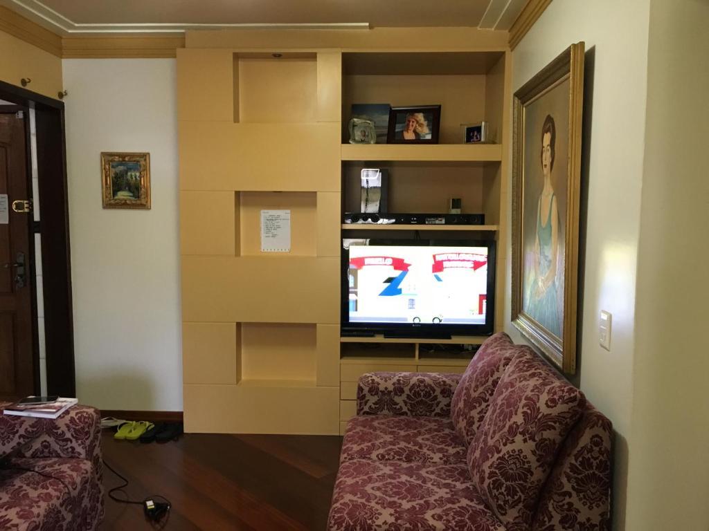 A television and/or entertainment center at Apartamento Luxo Balneário Camboriú