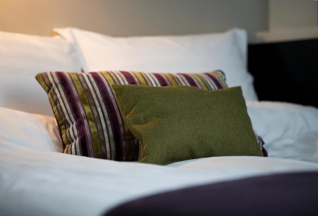 A bed or beds in a room at 22 Hill Hotel