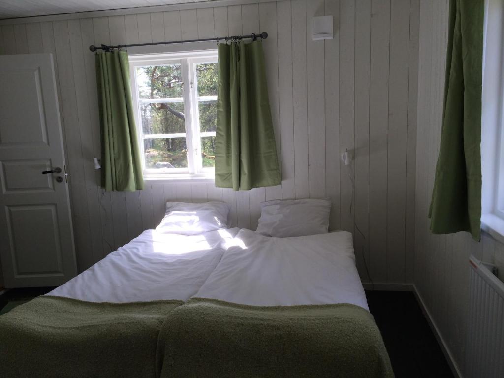 Säng eller sängar i ett rum på Ösjönäs