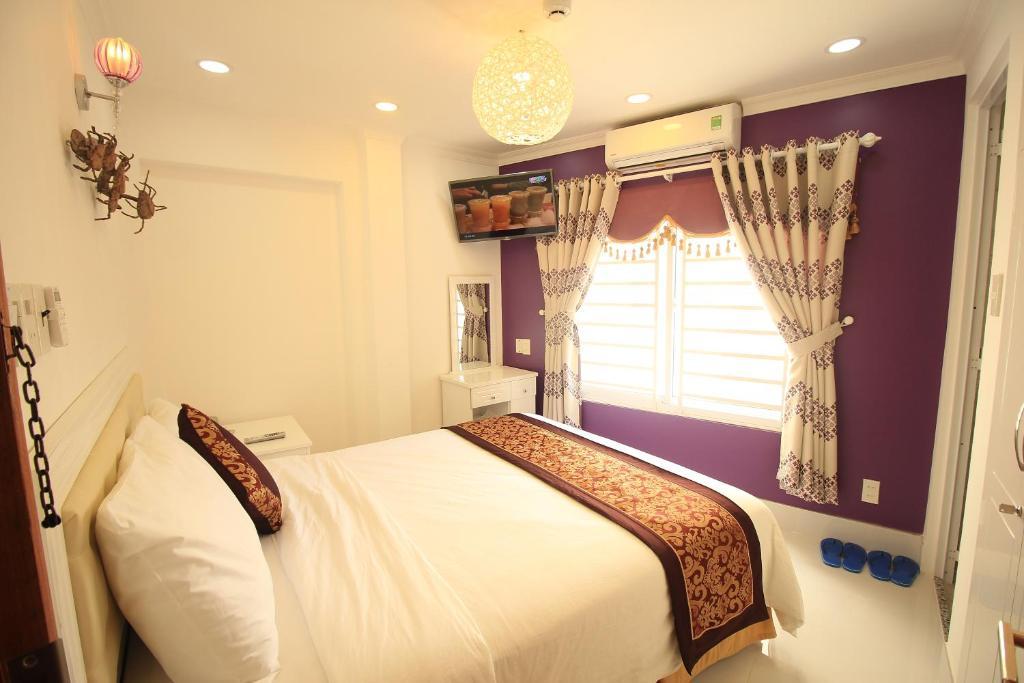 Cama o camas de una habitación en Nest Hotel