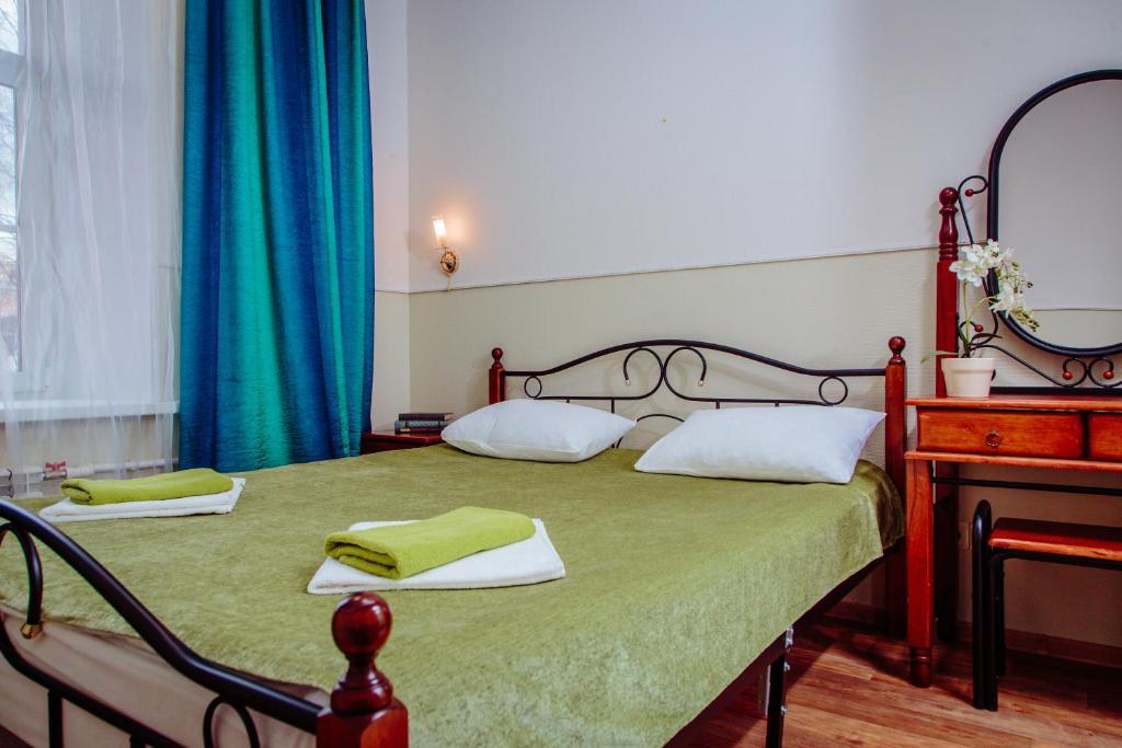 Кровать или кровати в номере Отель Берег