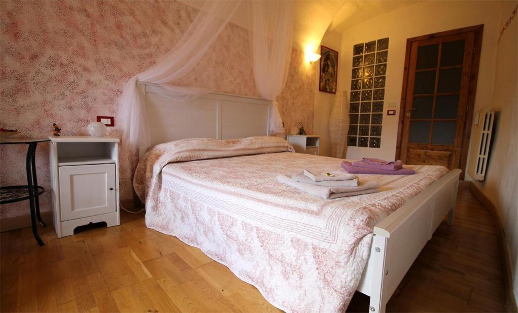 Een bed of bedden in een kamer bij La Stregatta