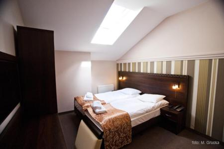 A bed or beds in a room at Hotel Kuban