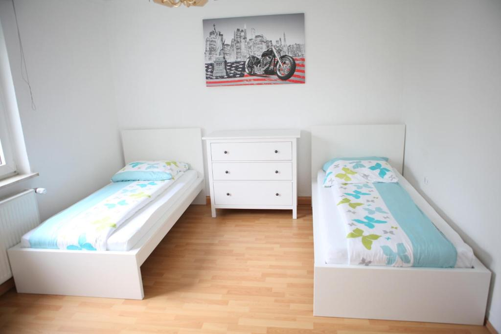 A bed or beds in a room at White House Bochum II