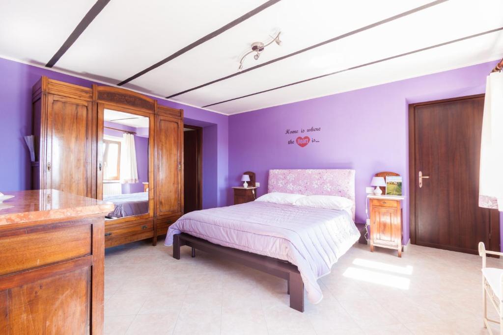 Letto o letti in una camera di Bed and Breakfast Val d'Oche