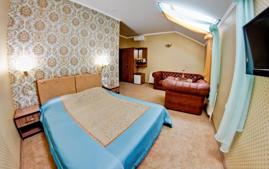 A bed or beds in a room at Zvezda Guest House