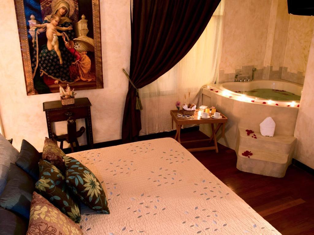 Cama o camas de una habitación en Andean Wings Boutique Hotel