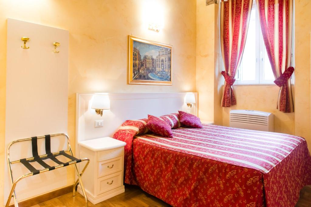 A bed or beds in a room at Domus Trevi