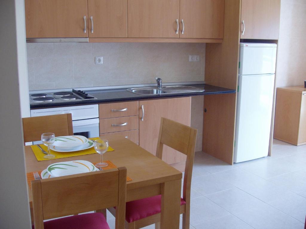 Kuchyň nebo kuchyňský kout v ubytování Flamingo