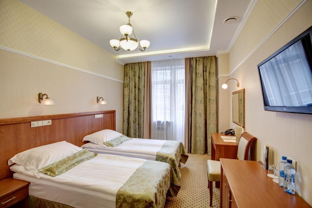 Кровать или кровати в номере Дегас Воронеж Центр
