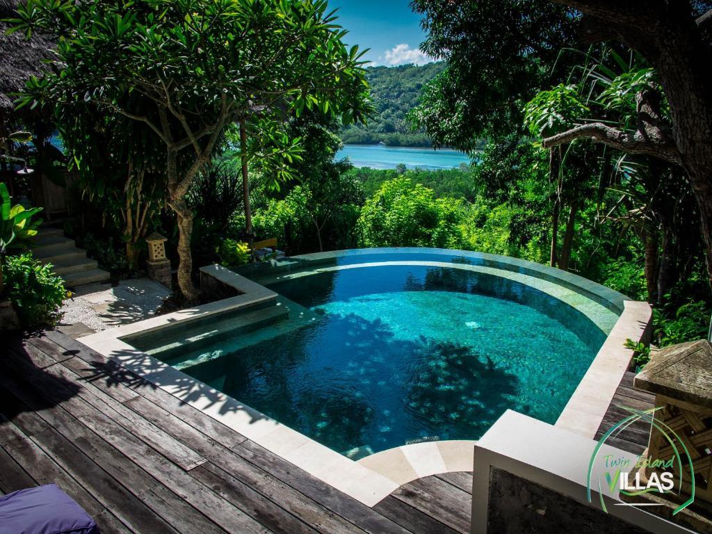 The swimming pool at or near Twin Island Villas & Dive Resort